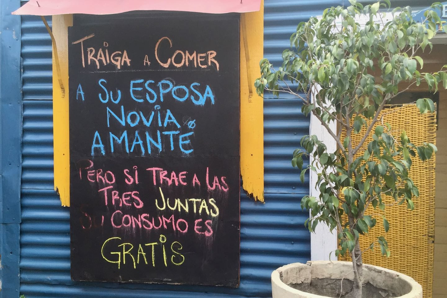 Funny signboard at a local restaurant in La Boca. Translation: Bring your wife, girlfriend or lover to eat but if you bring all three together the bill is on us.