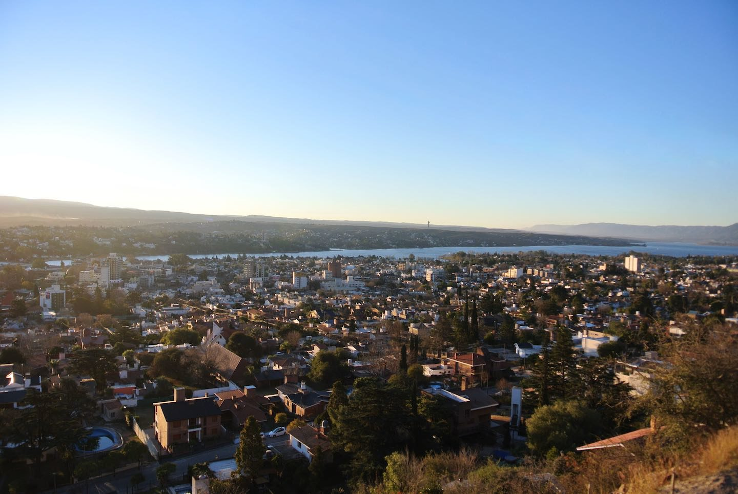 Panoramic view of Villa Carlos Paz at the sunset from the high grounds in the city.