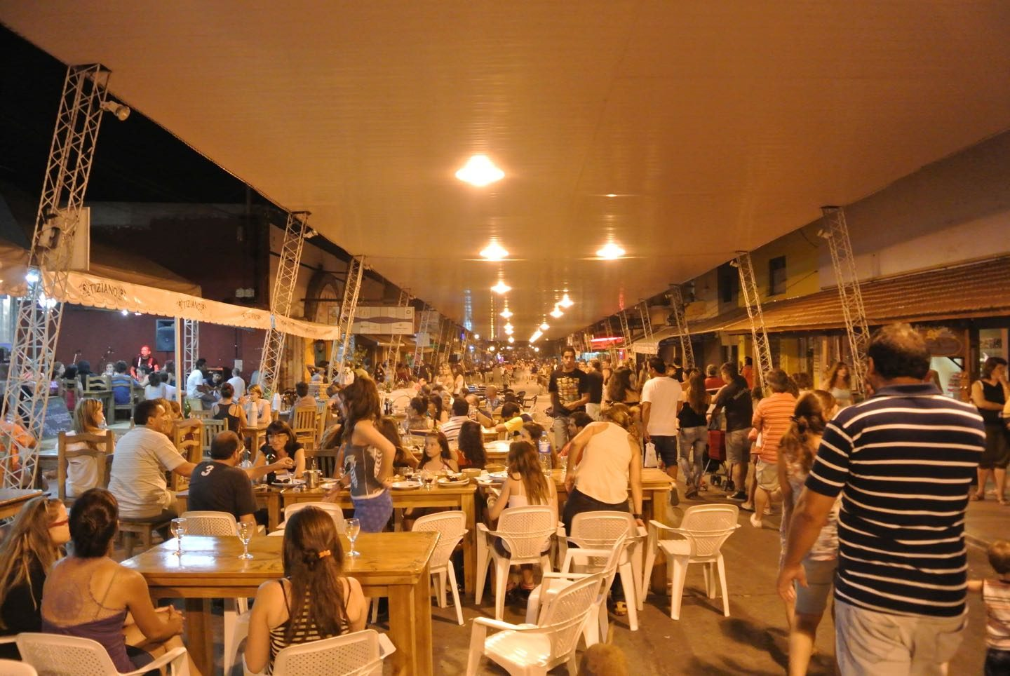 """La Techada"" at night, the commercial street of Capilla del Monte. The most touristic area in town, full of bars, restaurants and tour agencies."